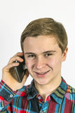 Teenage boy uses the mobile Royalty Free Stock Images