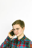 Teenage boy uses the mobile Stock Image