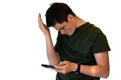Teenage boy using cellphone, he gets bad news Royalty Free Stock Image