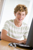 Teenage Boy Using Desktop Computer Stock Photos