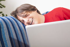 Teenage boy using laptop Royalty Free Stock Photo