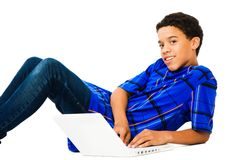Teenage Boy Using Laptop Stock Image