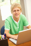 Teenage Boy Using Laptop At Home Stock Photos