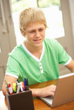 Teenage Boy Using Laptop At Home Royalty Free Stock Photo