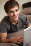 Teenage Boy Using Laptop At Home Royalty Free Stock Photos