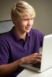 Teenage Boy Using Laptop At Home Royalty Free Stock Images