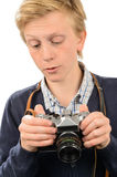 Teenage boy using retro camera Stock Photos