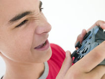 Teenage boy using video game controller Royalty Free Stock Images