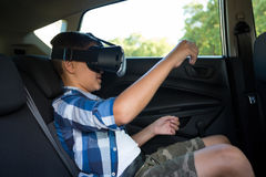 Teenage boy using virtual reality headset Royalty Free Stock Photography
