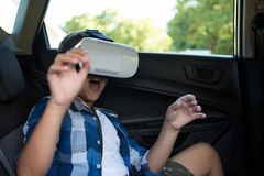 Teenage boy using virtual reality headset Stock Photography