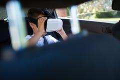 Teenage boy using virtual reality headset in the car Stock Photo