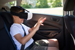 Teenage boy using virtual reality headset in the car Royalty Free Stock Photos