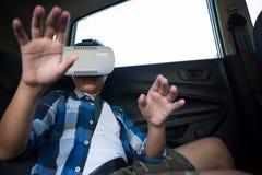 Teenage boy using virtual reality headset in the car Stock Photos