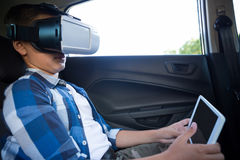Teenage boy using virtual reality headset with digital tablet Stock Images