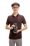 Teenage boy with a vintage outfit and an old camera Royalty Free Stock Photos
