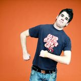 Teenage Boy Walking Funny. A teenage boy acting silly and walking funny with stiff arms stock photography