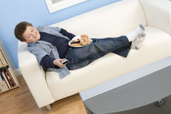 Teenage Boy Watching Television Royalty Free Stock Images