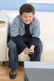 Teenage Boy Watching Television Royalty Free Stock Photos