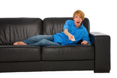 Teenage boy watching tv. On sofa Royalty Free Stock Photo