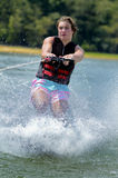 Teenage Boy Waterskiing. Closeup of teenage boy as he gets started skiing royalty free stock images