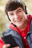 Teenage Boy Wearing Earphones Listening To Music Royalty Free Stock Photography
