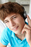 Teenage boy wearing headphones Stock Photos