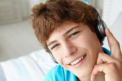 Teenage boy wearing headphones royalty free stock photography