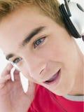 Teenage boy wearing headphones. Looking away from camera Stock Photos