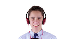 Teenage Boy Wearing Headphones And Listening To Music, Communicating by Phone. Isolated on white background. Stock Image