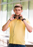 Teenage Boy Wearing Headphones And Listening To Music In Urban Royalty Free Stock Photos
