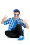 Teenage boy wearing huge orange and blue sunglasses, birthday party concept. Isolated on white Stock Image