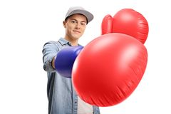 Teenage boy wearing a pair of big boxing gloves Stock Images