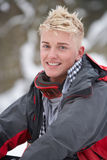 Teenage Boy Wearing Winter Clothes In Snow Stock Photo