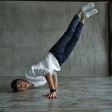 Teen boy doing breakdancing Royalty Free Stock Photo
