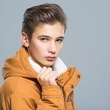 Teenage boy in winter clothes Stock Images