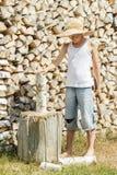 Teenage boy during wood chopping Stock Photos