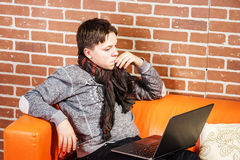 Teenage boy working on laptop. Concentration and composure. Royalty Free Stock Photography