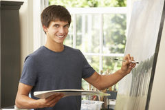 Teenage Boy Working On Painting In Studio Stock Image