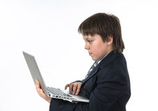 Teenage boy working in white laptop Royalty Free Stock Photos