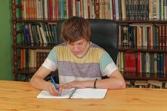 Teenage Boy Writing royalty free stock images