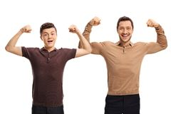 Teenage boy and a young man flexing their biceps Stock Images