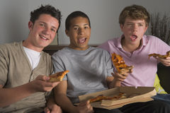 Teenage Boys Enjoying Pizza Royalty Free Stock Images