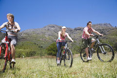 Teenage Boys And Girl Biking Outdoors Royalty Free Stock Photo
