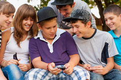 Teenage boys and girls having fun outdoor. On beautiful spring day royalty free stock photos