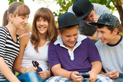 Teenage boys and girls having fun outdoor. On beautiful spring day royalty free stock photography