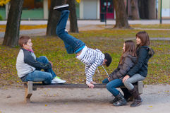 Teenage boys and girls having fun in the park. On beautiful autumn day royalty free stock photo