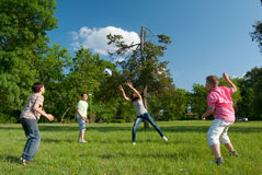 Teenage boys and girls playing with the ball Stock Images