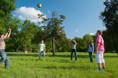 Teenage boys and girls playing with the ball in the park Stock Images