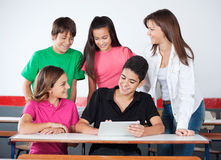 Teenage Boys And Girls Using Digital Tablet At Royalty Free Stock Image