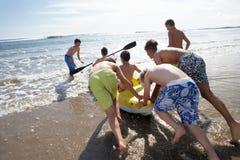 Teenage boys kayaking royalty free stock photo